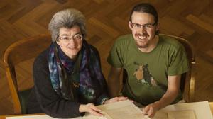 Dr Catherine Batt and Dr Alaric Hall in the University of Leeds' Brotherton Library with papers from the Gordon-Tolkien Collection