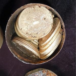 One of the six decaying metal canisters filled with 1800s-era US gold coins unearthed in California by two people who want to remain anonymous (AP/Saddle Ridge Hoard discoverers via Kagin's, Inc)