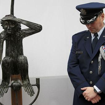 US Air Force Lieutenant-Colonel Sean Cosden stands in the garden of O'Donovan's Hotel in Cork during the unveiling of the Tojo statue