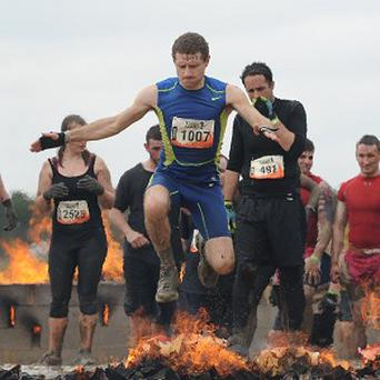 Competitors take part in Tough Mudder 2013 at Boughton House, Kettering