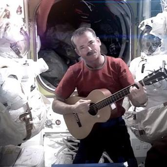 Astronaut Chris Hadfield recording the first music video from space with his cover of David Bowie's Space Oddity (AP/Nasa)