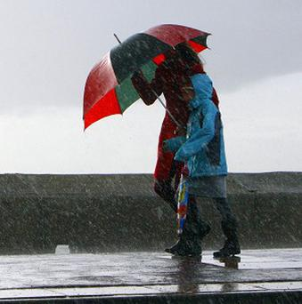 The Welsh First Minister says bad weather is to blame for a drop in tourist numbers