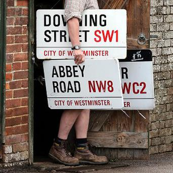 An enamelled Downing Street sign was bought by advertising executive Trevor Beattie for 7,800 pounds