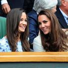 The Duchess of Cambridge and her sister Pippa in the Royal Box during the 2012 Wimbledon Championships