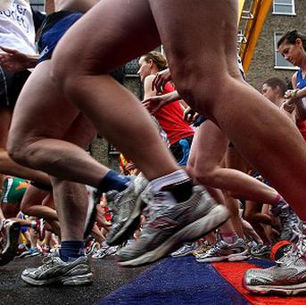 A US woman training for a half-marathon was shocked to find her sore back was labour pains from an unknown pregnancy