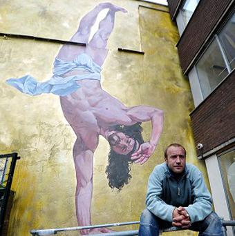 Artist Cosmo Sarson with his new mural called Breakdancing Jesus