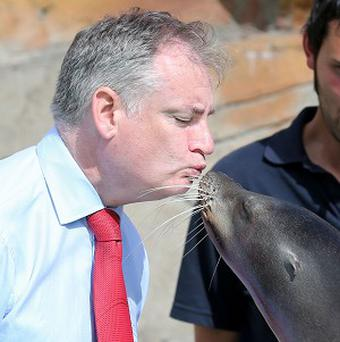 Richard Lockhead gets a kiss from Poppy the sea lion, watched by keeper Sam Clark
