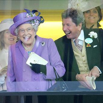 The Queen with her racing manager John Warren after her horse, Estimate, won the Gold Cup