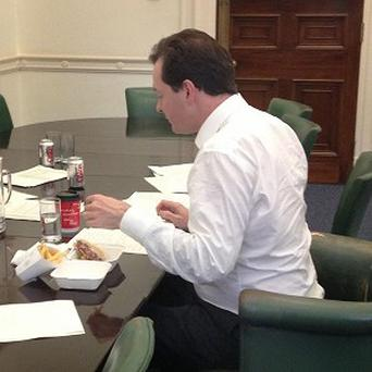 George Osborne eating a burger and chips as he puts the finishing touches to the spending review (George Osborne/PA)