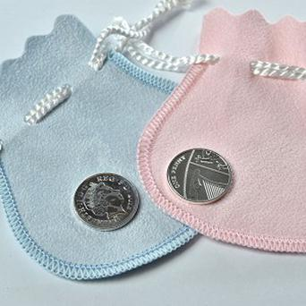 A new silver penny will be gifted to babies born on the same day the Duke and Duchess of Cambridge's baby (The Royal Mint/PA)
