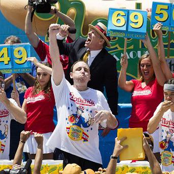 Joey Chestnut wins the Famous Fourth of July International Hot Dog Eating contest in Brooklyn, New York (AP)