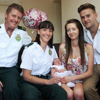 ECA Nigel Goodman and paramedic Nikki Wildman pose with baby Ella, mother Melissa Cavanagh and father Paul Yeomans (West Midlands Ambulance Service/PA)