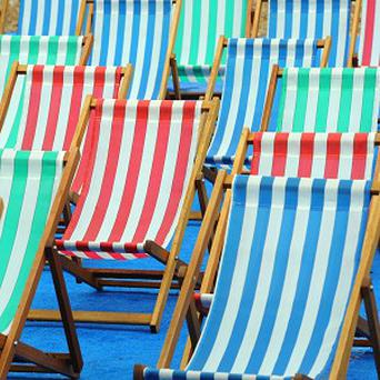 A woman has been rescued from a deckchair in her garden in Polruan, Cornwall