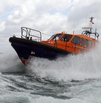 RNLI volunteers rescued a man from the sea after a seal caused him to capsize