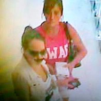 Photo issued by Wiltshire Police of two women, one wearing a fake nose and moustache, wanted in connection with the theft of a bottle of perfume from a Boots store in Salisbury