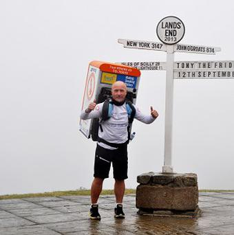 Tony Phoenix-Morrison completes his John O'Groats to Lands End run with a fridge on his back