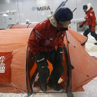 Prince Harry leaves his tent during a cold chamber training exercise with the Walking with the Wounded South Pole Allied Challenge 2013 British team