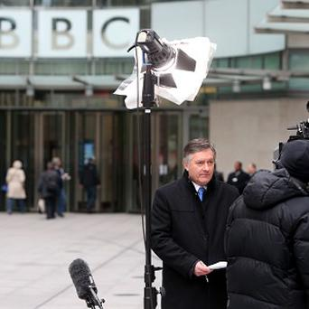 BBC News's Simon McCoy picked up a stack of photocopier paper rather than an iPad before presenting life to air