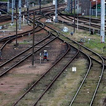 A 20-year-old man in Australia narrowly avoided being killed after darting across railway tracks