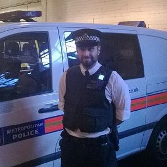 Pc Robert Morgan helped to deliver a baby girl in a car showroom after being flagged down by the father (Metropolitan Police/PA)