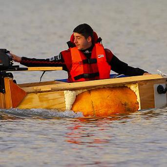 Contemporary artist Dmitri Galitzine in his 500kg pumpkin boat