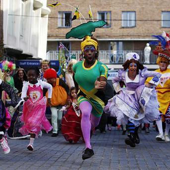 Pantomime dames take part in the 1km Dame Dash charity run in Hackney