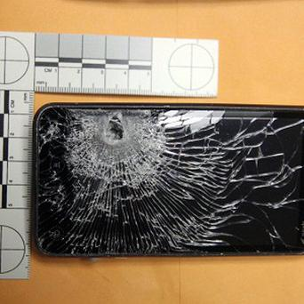 The back of the mobile phone belonging to a petrol station clerk that stopped a bullet fired at him during a robbery (AP/Winter Garden Police)
