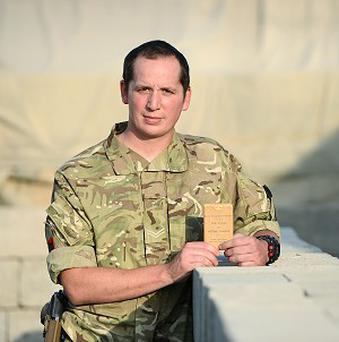Corporal David Coles is to return his grandfather's Second World War Bible to him after carrying it in his body armour during a tour of Afghanistan (MoD/PA)