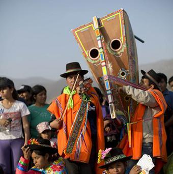 Musicians play folk music in the Nueva Esperanza cemetery during the Day of the Dead in Lima (AP)