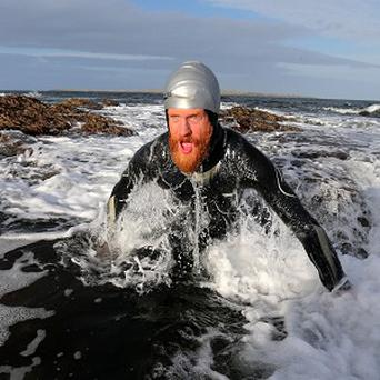 Swimming 'nutter' Sean Conway, 32, arrives in John O'Groats