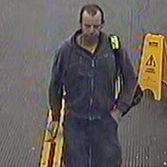 The man police are hunting after he stole a wheelchair ramp from a railway station (British Transport Police/PA)