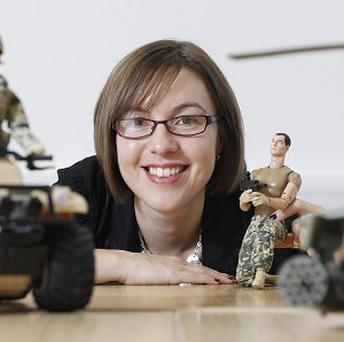 Dr Tara Woodyer, from the University of Portsmouth, with action figure dolls as scientists are to examine whether they help form children's opinions on war (University of Portsmouth/PA)