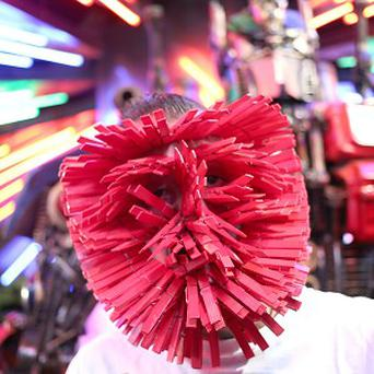 Kelvin Mercado, also known as Peg Man, breaks the record of how many pegs one person can put on their face at the launch of Ripley's Believe It Or Not 2014 annual