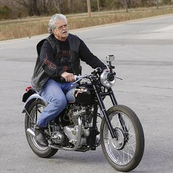 Donald DeVault, 73, rides his motorcycle after being reunited with it 46 years after it was stolen (AP)