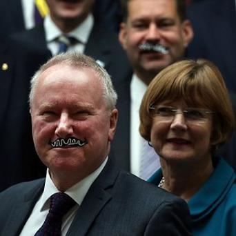 Health Secretary Alex Neil poses for photographs with MSPs for Movember at the Scottish Parliament in Edinburgh