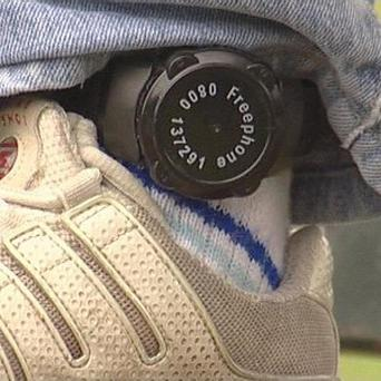 Embargoed to 0001 Friday March 23Undated BBC handout image of an electronic tag on an offender's ankle.