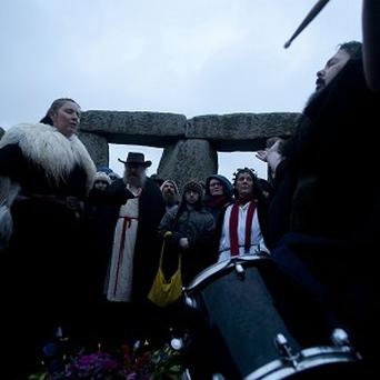 Druids at the Winter Solstice in Stonehenge on the morning of the shortest day of the year