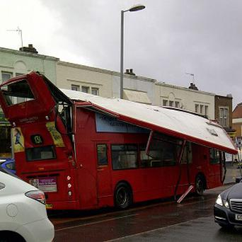 A London bus after it crashed into a bridge near Norbiton station.