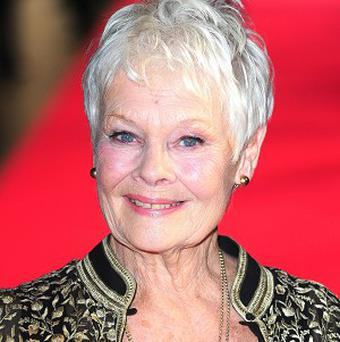 Dame Judi Dench, who plays 007's boss M, told how she was late for lunch with the boss of MI6 when the driver sent by the Intelligence Service could not find where to pick her up