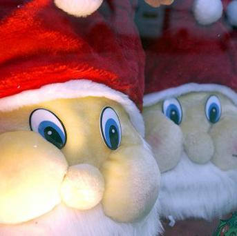 A Santa Claus was told to stop entertaining children after two Father Christmases showed up in the same high street