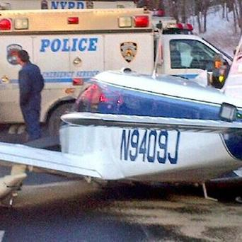 The light aircraft landed on the Major Deegan Expressway in the Bronx borough of New York City (AP)