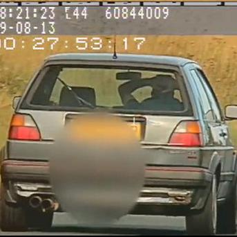 Video still issued by North Yorkshire Police showing Richard Newton, 36, driving at 60mph with no hands on the A171 near Scaling Dam reservoir in August of last year, as he has been banned from driving for 12 months at Scarborough Magistrates Court.