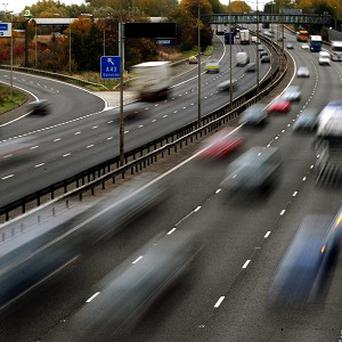 File photo dated 26/10/09 of traffic on the M1 motorway as motorists with 30 or more penalty points on licences are still driving, according to figures.