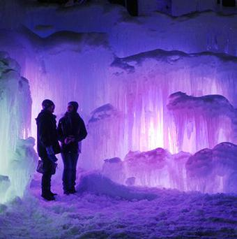 Patrons tour an ice castle at the base of the Loon Mountain ski resort in Lincoln, New Hampshire (AP)