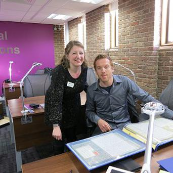 Damian Lewis with archivist Geraldine Hunwick at Newcastle University's Robinson Library
