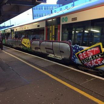 A graffiti tribute to the late Only Fools And Horses actor Roger Lloyd-Pack, on the side of a Southern train carriage (Andrew Paulson)