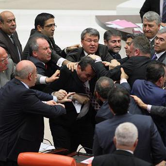 Ruling party MPs and the members of the main opposition fight each other in Turkey's parliament (AP)