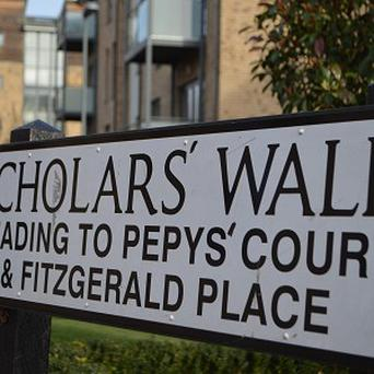 A street sign on Scholars' Walk in Cambridge which has been altered using marker pens to fill in allegedly missing apostrophes by grammar campaigners.