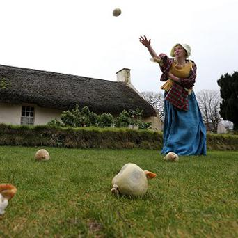 Curator Rebecca Stapley dons 18th-century costume as she practices haggis hurling ahead of the weekend championship