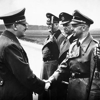 Adolf Hitler shaking hands with German Interior Minister and head of the SS, Heinrich Himmler (AP Photo/str,File)